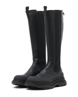 Tread slick knee high boots