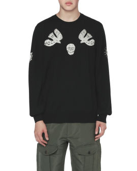 Embroidered papercut motif sweater