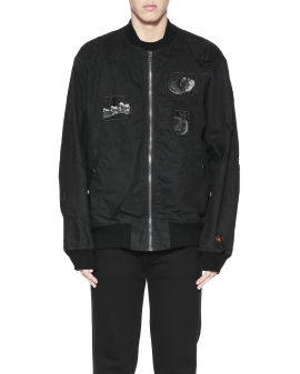 Graphic patched bomber jacket