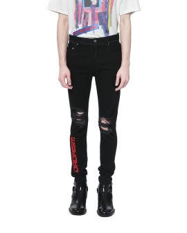 Distressed patch slim jeans